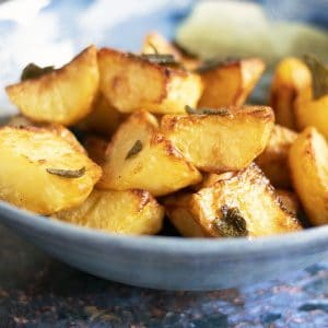 close up shot of sage roast potatoes in bowl