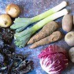 february seasonal vegetables - sprout tops, onions, leeks, carrots, potatoes, radicchio and beetroot