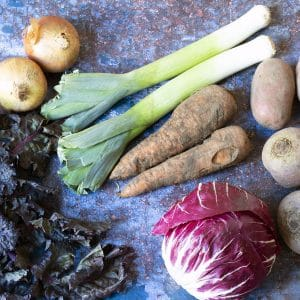 february seasonal vegetables - sprout tops, onions, leeks, carrots, potatoes, radicchio and beetroot