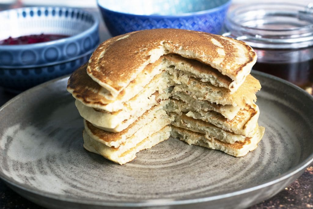 stack of vegan pancakes on ceramic plate