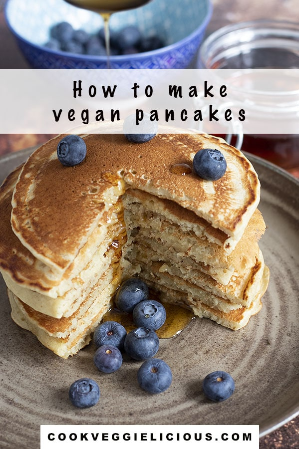 stack of vegan pancakes with blueberries on ceramic plate