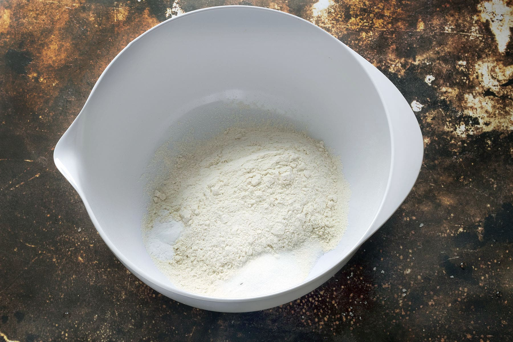 flour, bicarbonate of soda and sugar in white bowl