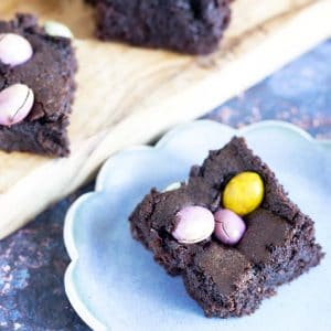 vegan mini egg brownies on board and blue plate