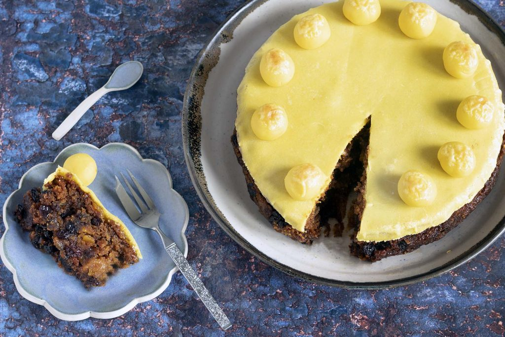 vegan easter simnel cake - overhead shot with one slice cut out