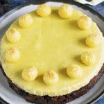 overhead shot of vegan easter simnel cake on ceramic plate