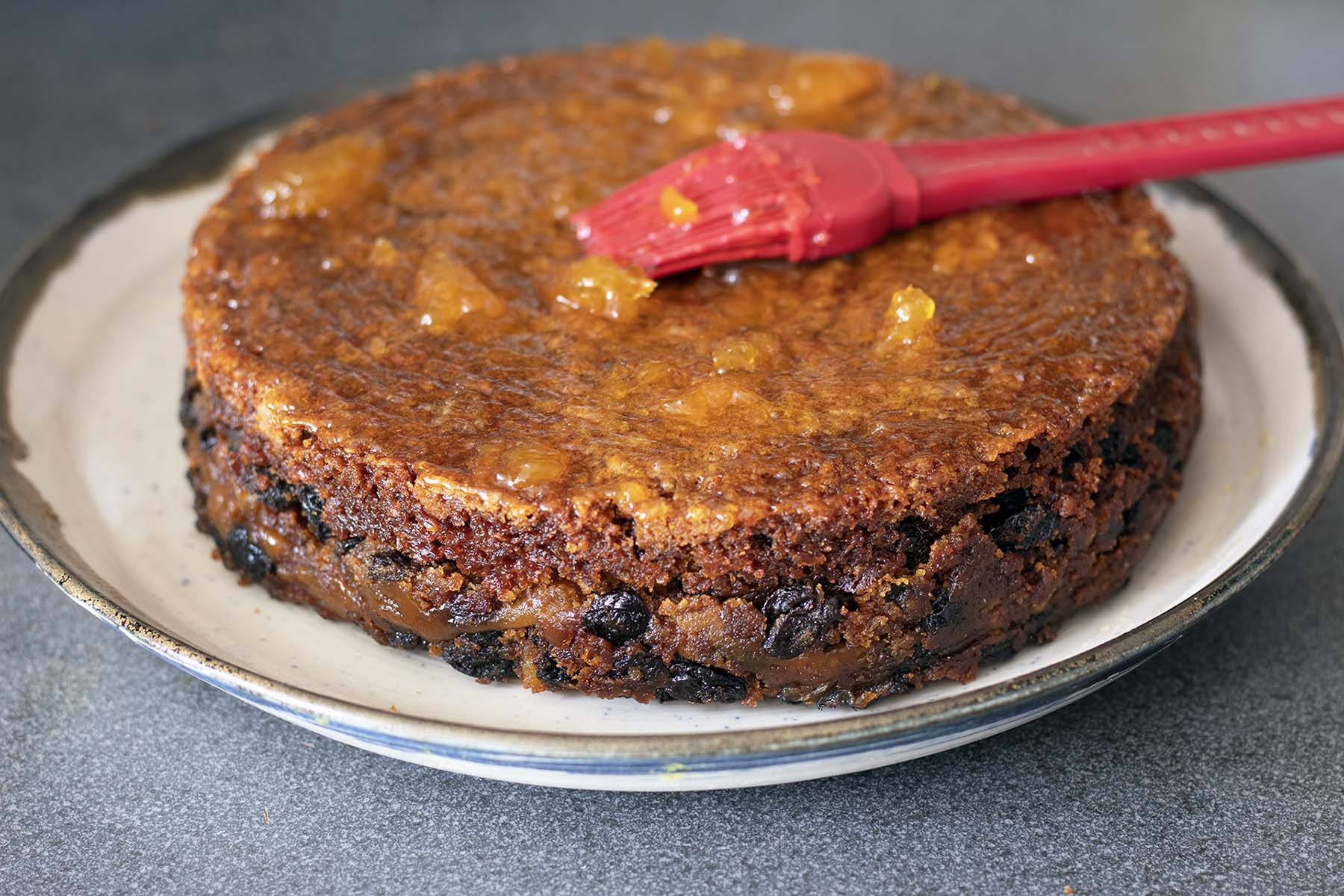 simnel cake brushed with apricot jam
