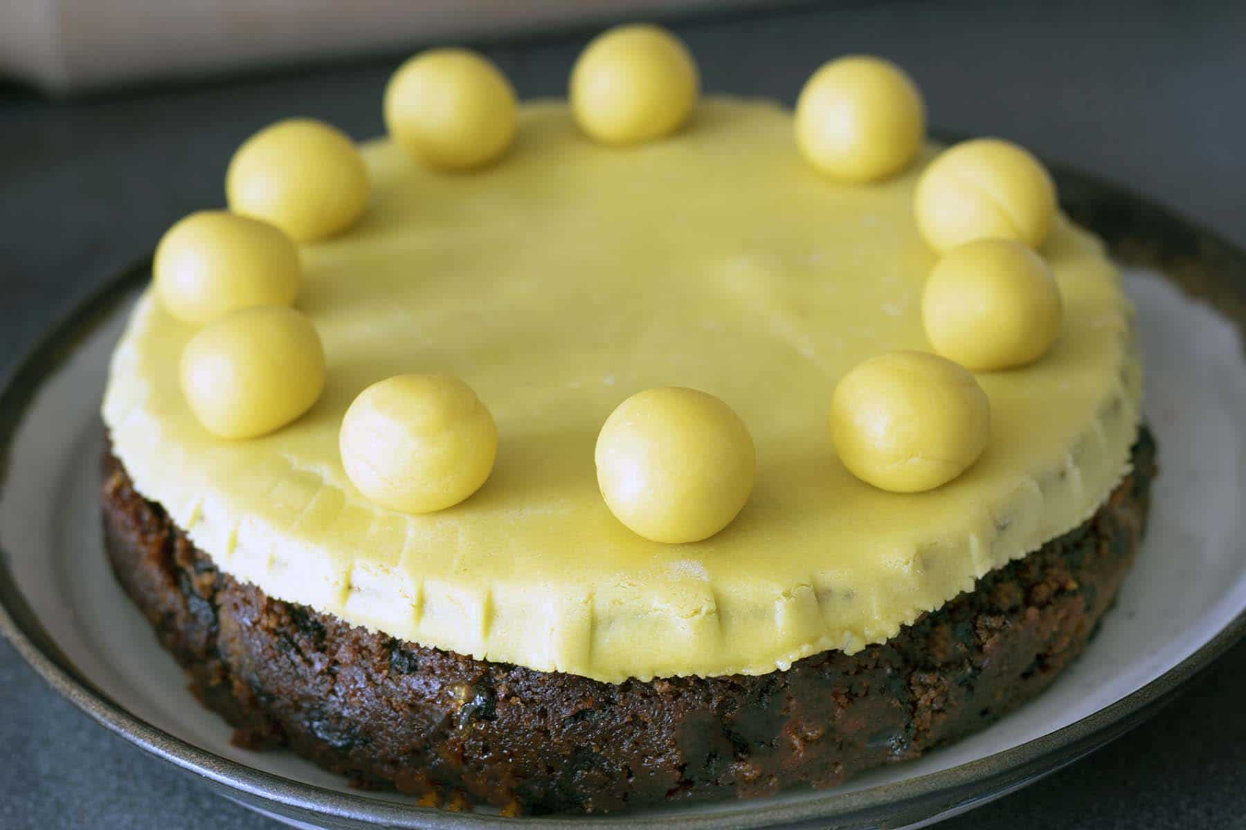 simnel cake topped with marzipan and marzipan balls