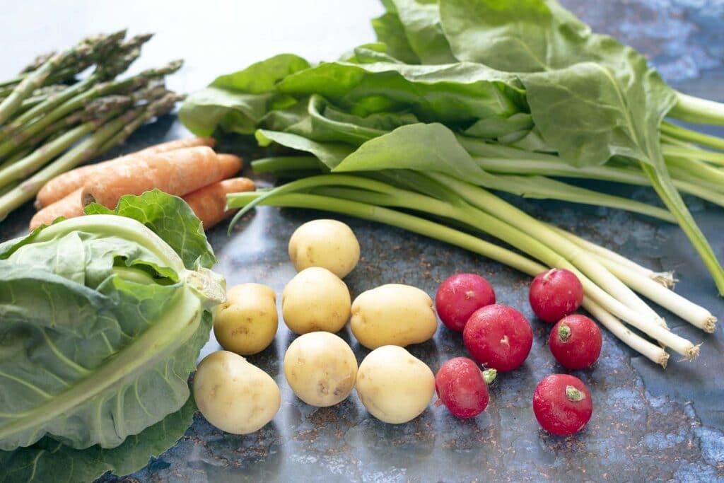 May seasonal vegetables on blue background