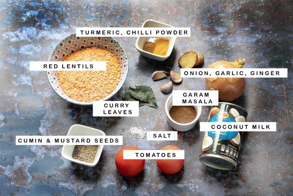 ingredients for dal on blue backdrop with text labels