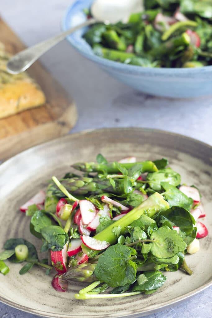 asparagus salad on brown plate