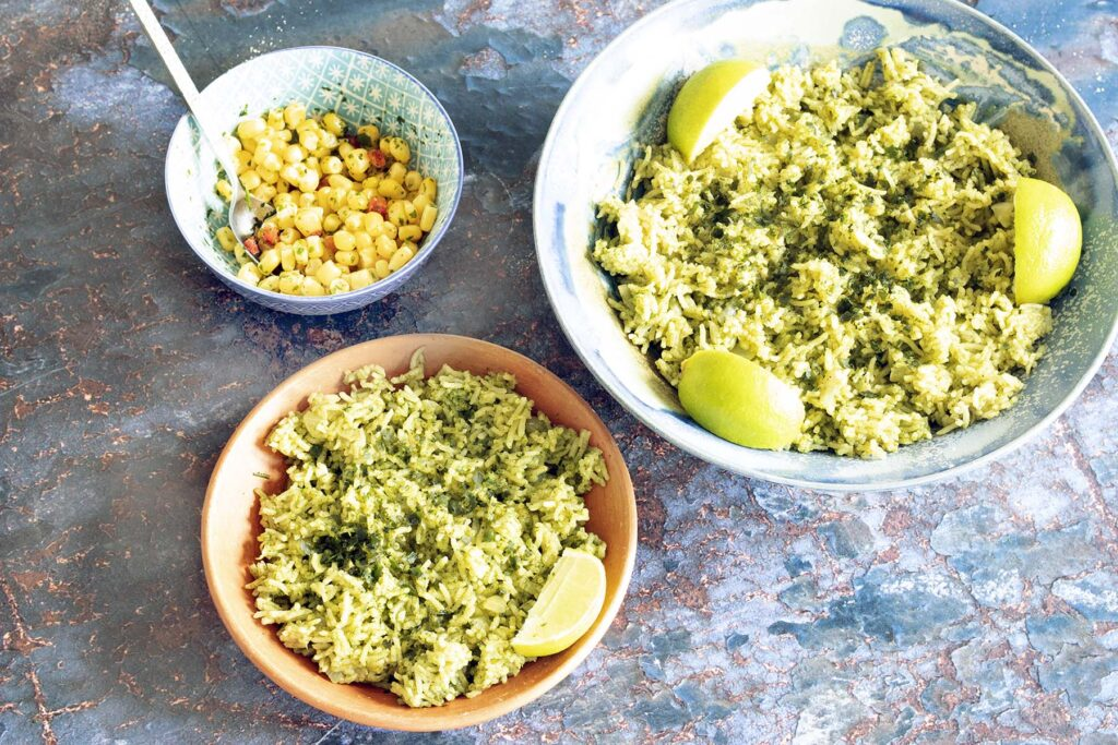 overhead shot - green rice with lime and sweetcorn salad