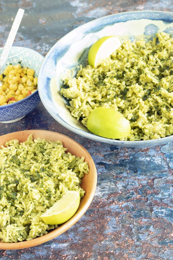 green rice in bowls with sweetcorn salad