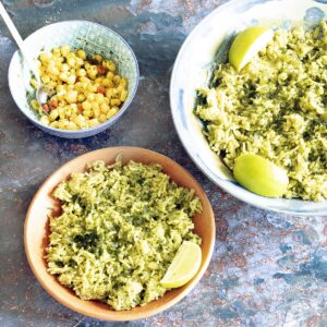 green rice with lime wedges