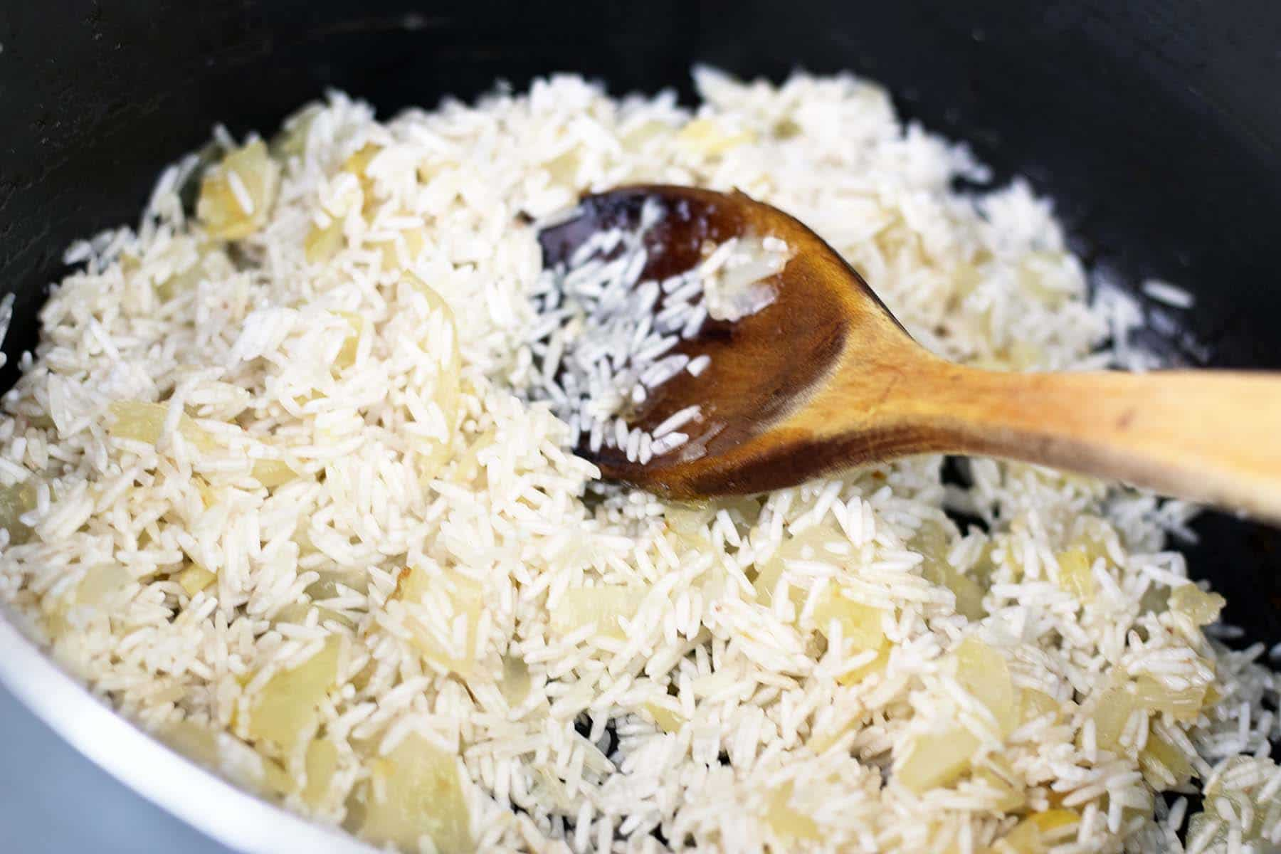 rice in saucepan with fried onions