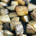 close up of roasted swede cubes in roasting tin