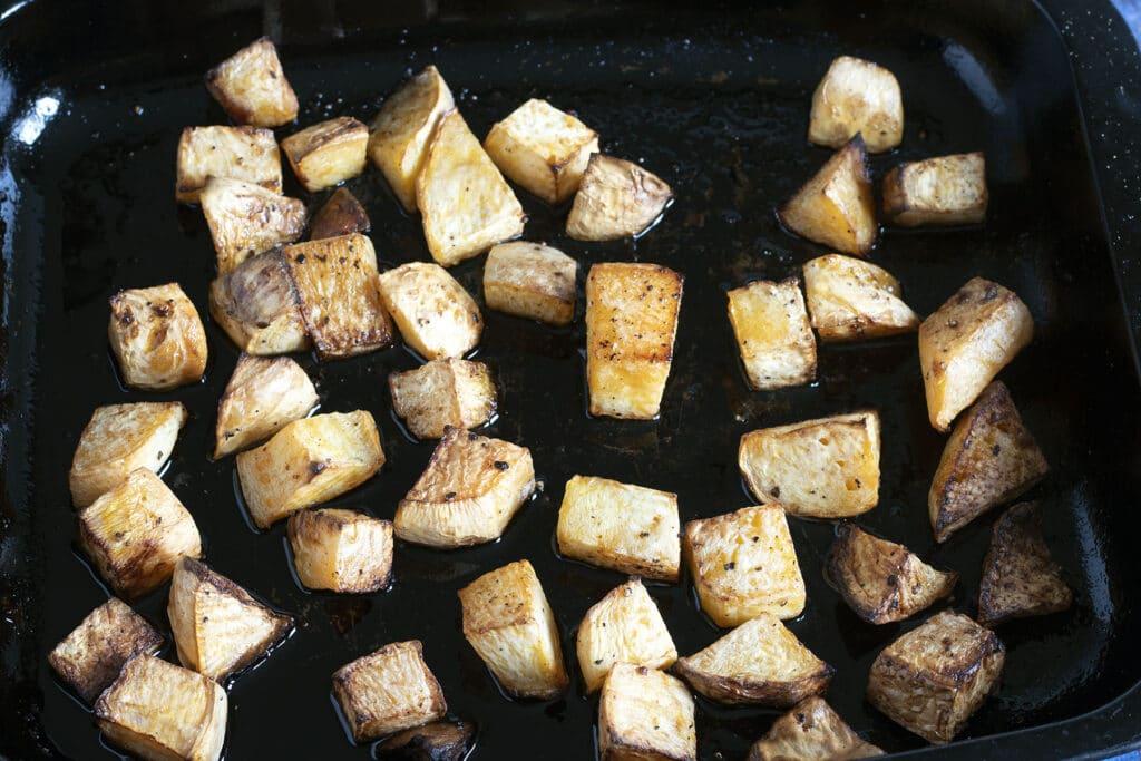 roasted rutabaga (swede) in black roasting tin
