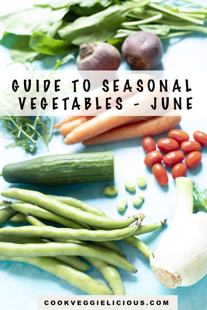 broad beans, rocket, beetroot, carrots, tomatoes, cucumber and fennel on blue background - vegetables in season in June