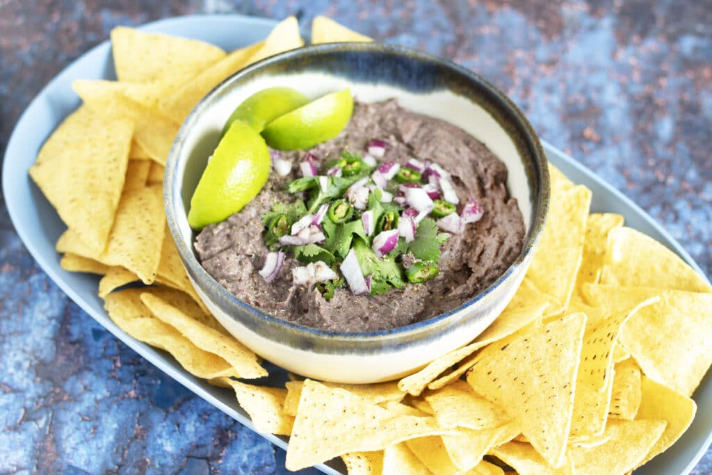 black bean dip in bowl with tortilla chips
