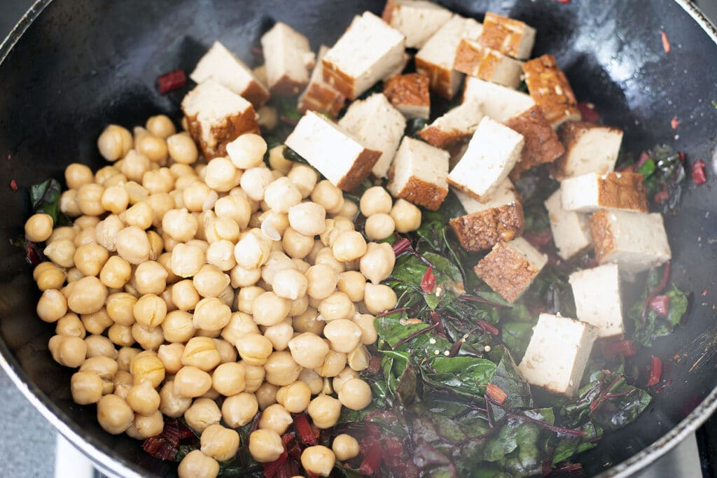 chard in wok with tofu and chickpeas