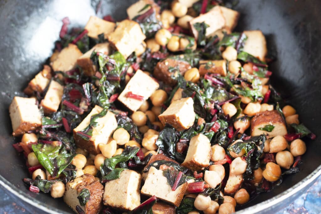 chard with tofu and chickpeas in wok